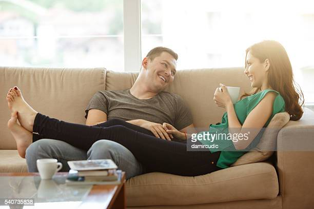 Couple relaxing on sofa in their new home
