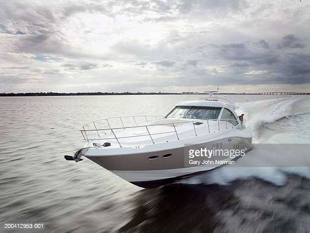 Couple relaxing on speed boat, dawn, elevated view