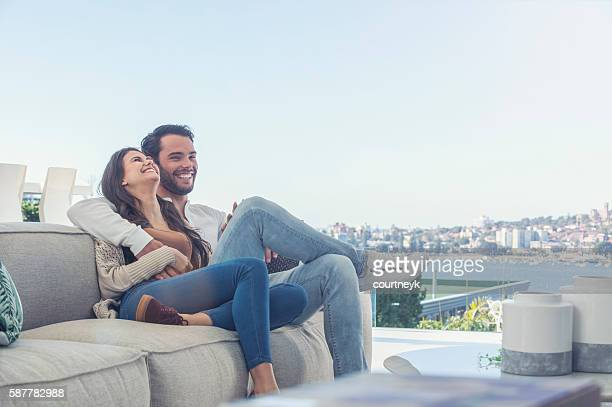 Couple relaxing on the sofa.