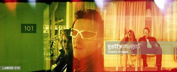 couple relaxing outside motel room (multiple exposure) - anti gravity stock photos and pictures