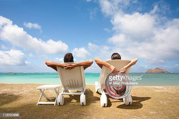 couple relaxing - outdoor chair stock pictures, royalty-free photos & images