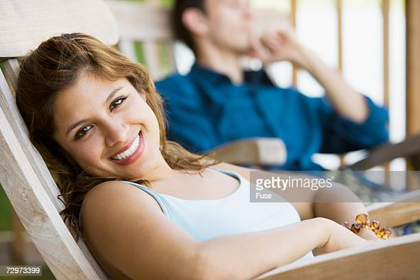 couple relaxing - アウトドアチェア ストックフォトと画像