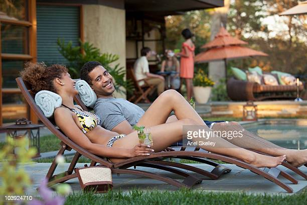 couple relaxing poolside - tourist resort stock pictures, royalty-free photos & images