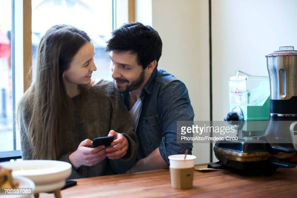 Couple relaxing together in coffee shop