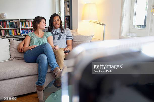 Couple relaxing together in living room