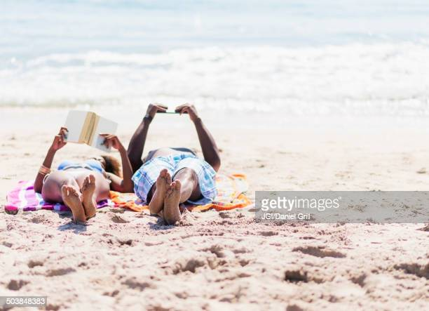 Couple relaxing together on beach