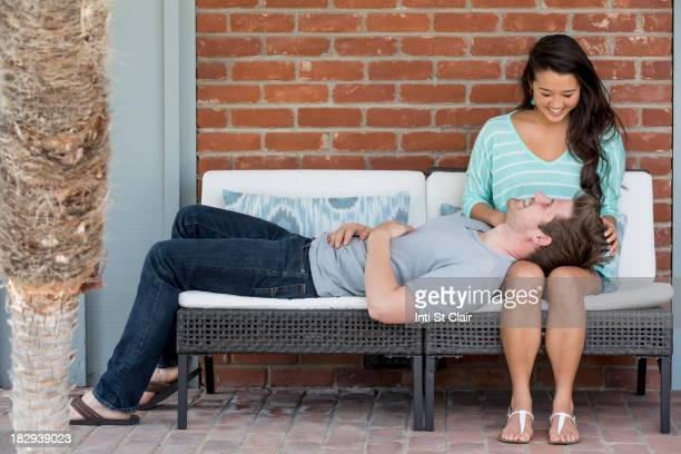 Couple relaxing together on bench