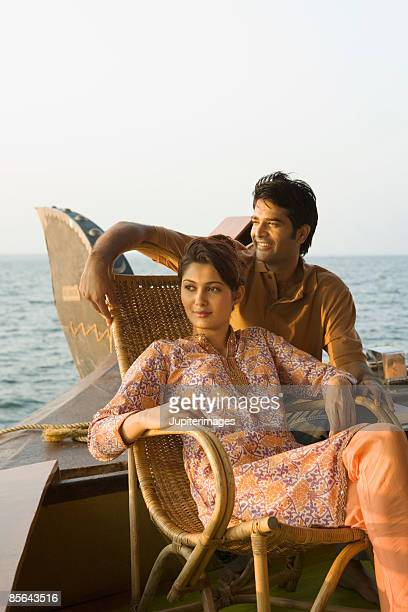 Couple relaxing together on houseboat, India