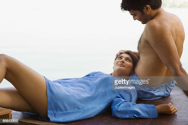 Couple relaxing together on houseboat