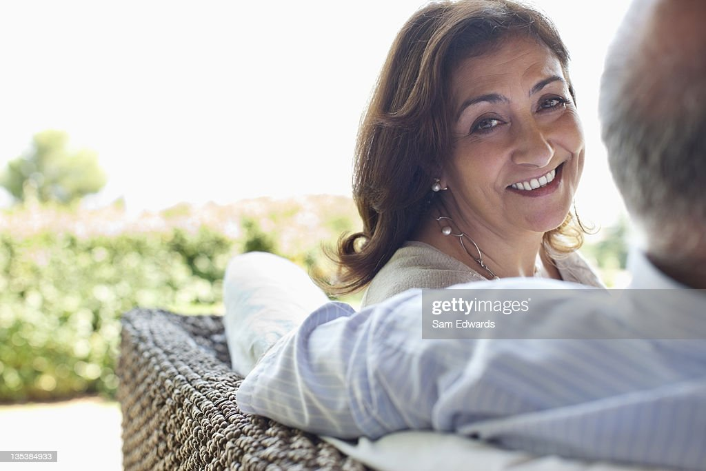Couple relaxing together on patio : Stock Photo