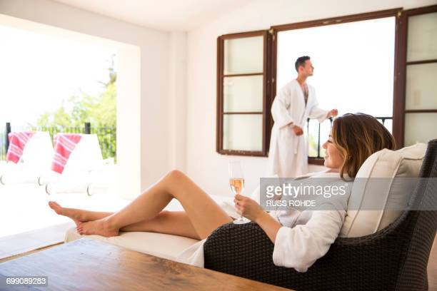 Couple relaxing with champagne in boutique hotel suite, Majorca, Spain