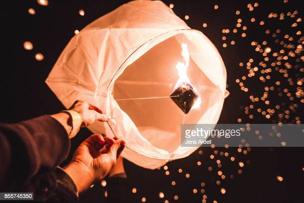 Couple Releasing Paper Lantern in Sky