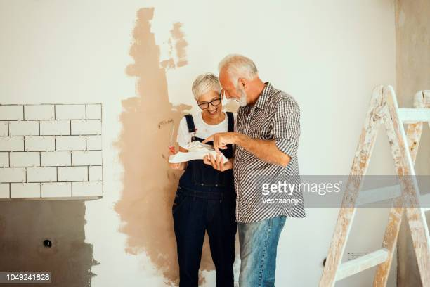 couple remodeling their home - home improvement stock pictures, royalty-free photos & images