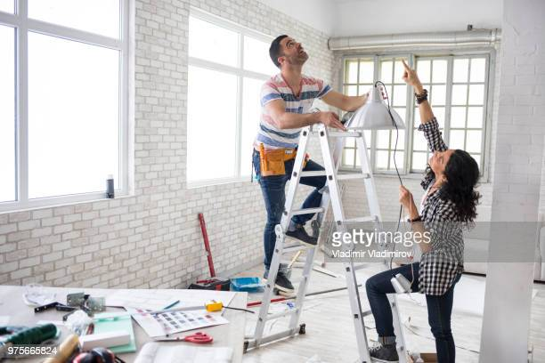 couple renovating their apartment - home improvement stock pictures, royalty-free photos & images