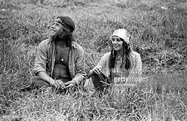 A couple rest on the grass at the Woodstock Music Art Fair Bethel NY August 15 1969