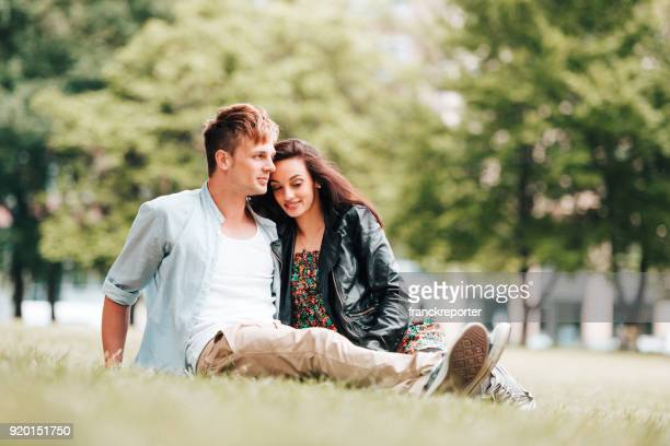 couple resting and flirting in the park