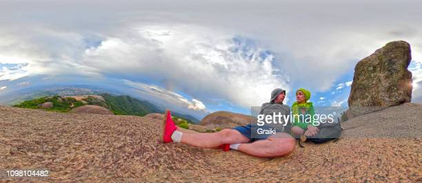 couple resting at the pedra grande mountain - hdri 360 ストックフォトと画像