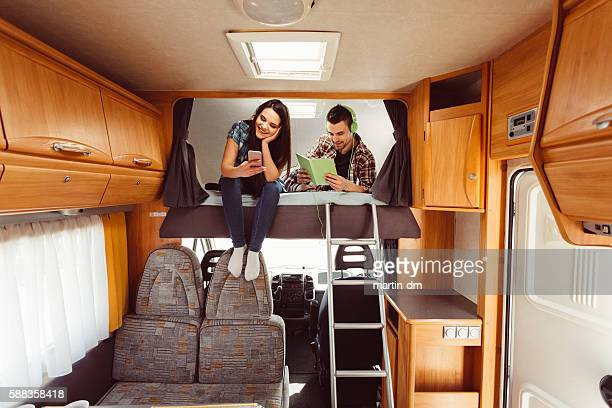 Couple resting in campervan