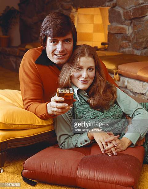 couple resting on cushion, smiling, portrait - 1976 stock pictures, royalty-free photos & images