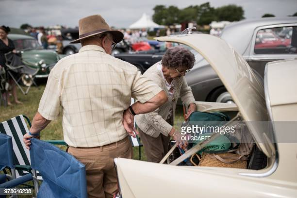 A couple retrieve items from the boot of their classic car displayed on the first day of The Royal Cheshire County Show at Tabley near Knutsford...