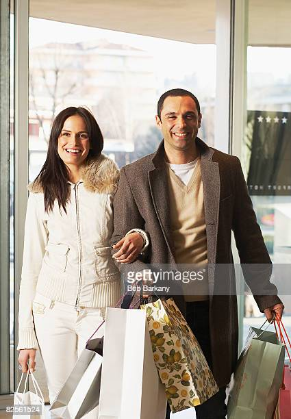Couple returning from shopping spree
