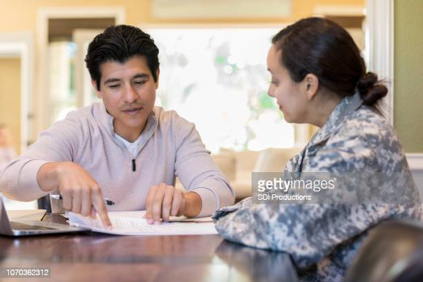 couple review legal documents - military spouse stock pictures, royalty-free photos & images