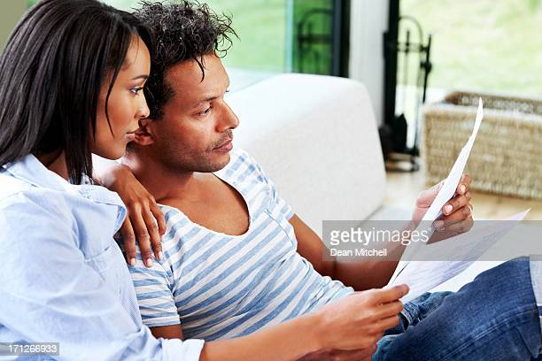 Couple reviewing documents at home
