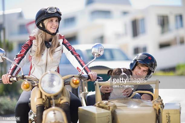 Couple riding a motorbike