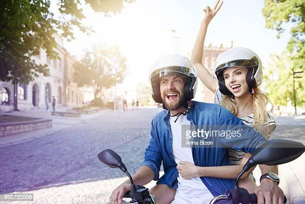 couple riding a motorbike wearing helmets. sandomierz, poland.  - capacete esportivo - fotografias e filmes do acervo