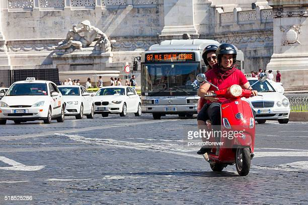 Couple riding a scooter in Rome, Italy
