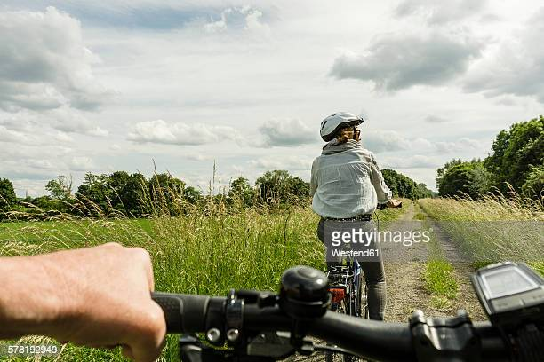 Couple riding bicycle at countryside