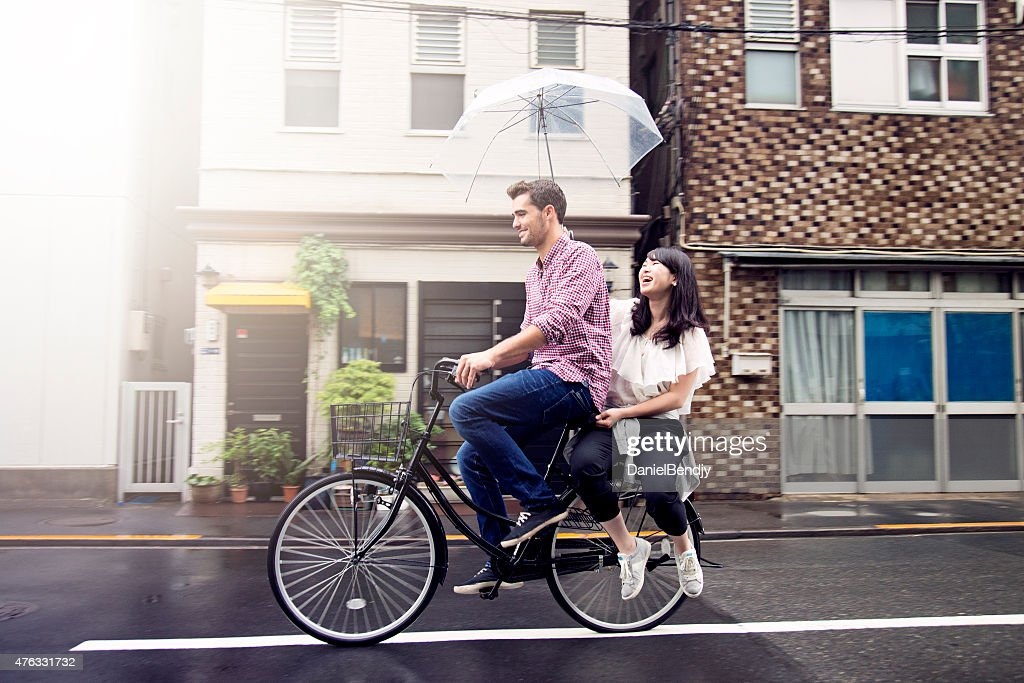 Couple Riding Bicycle On Rainy Day In Tokyo Stock Photo Getty Images