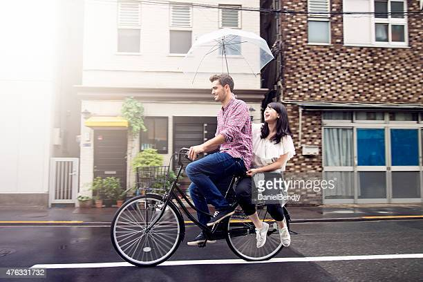 Couple Riding Bicycle on Rainy Day in Tokyo
