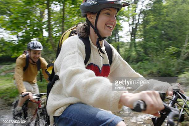 couple riding bicycles in countryside - cycling helmet stock pictures, royalty-free photos & images