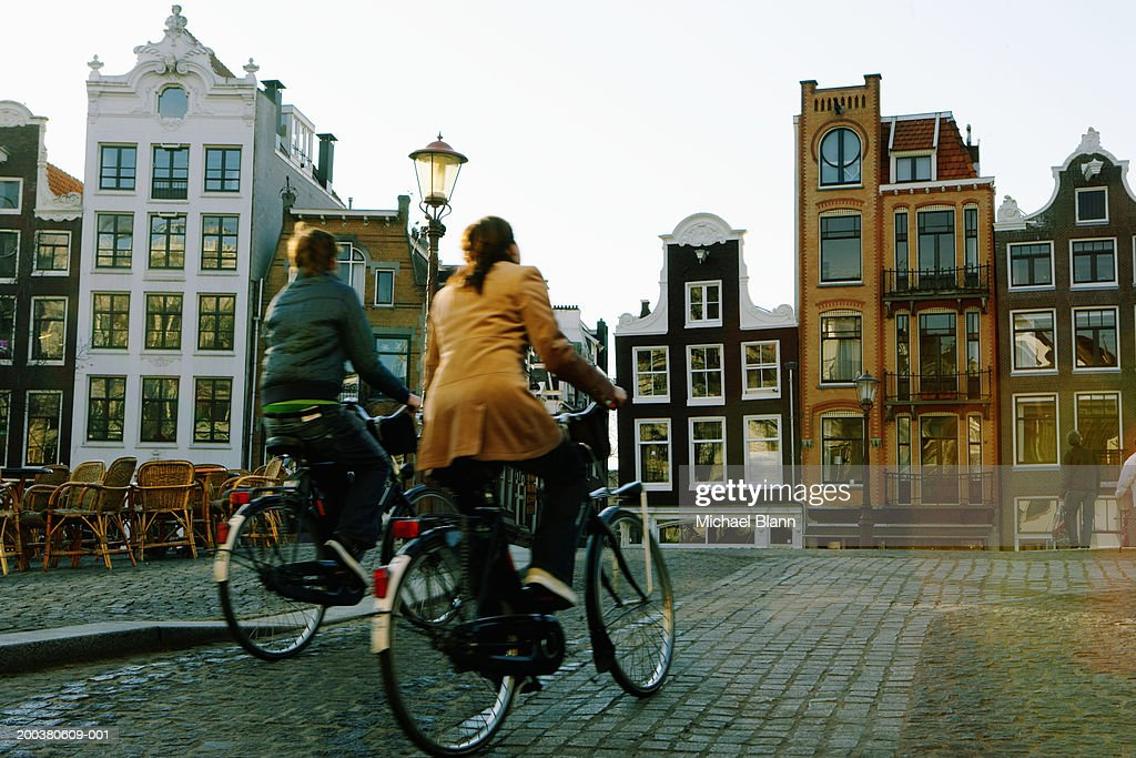 Couple riding bicycles, rear veiw (blurred motion) : Stock Photo