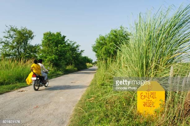 Couple riding bike, Chhapaiya near Ayodhya, Faizabad, Uttar Pradesh, India