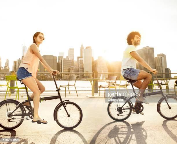 Couple riding bikes in New York City