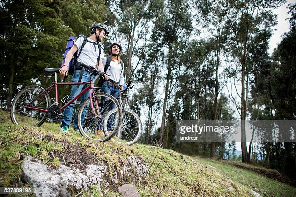 Couple riding bikes in the countryside