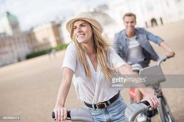 Couple riding bikes outdoors