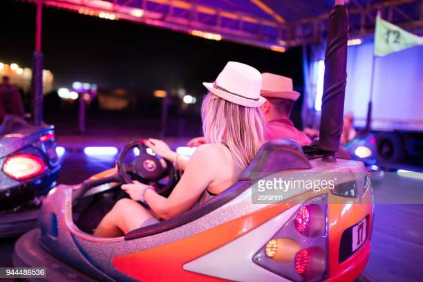 Couple riding bumper cars