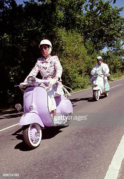 Couple riding his and hers scooters, The Isle of Wight scooter rally, august 2005.