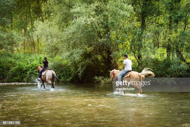 Couple riding horses in Italy