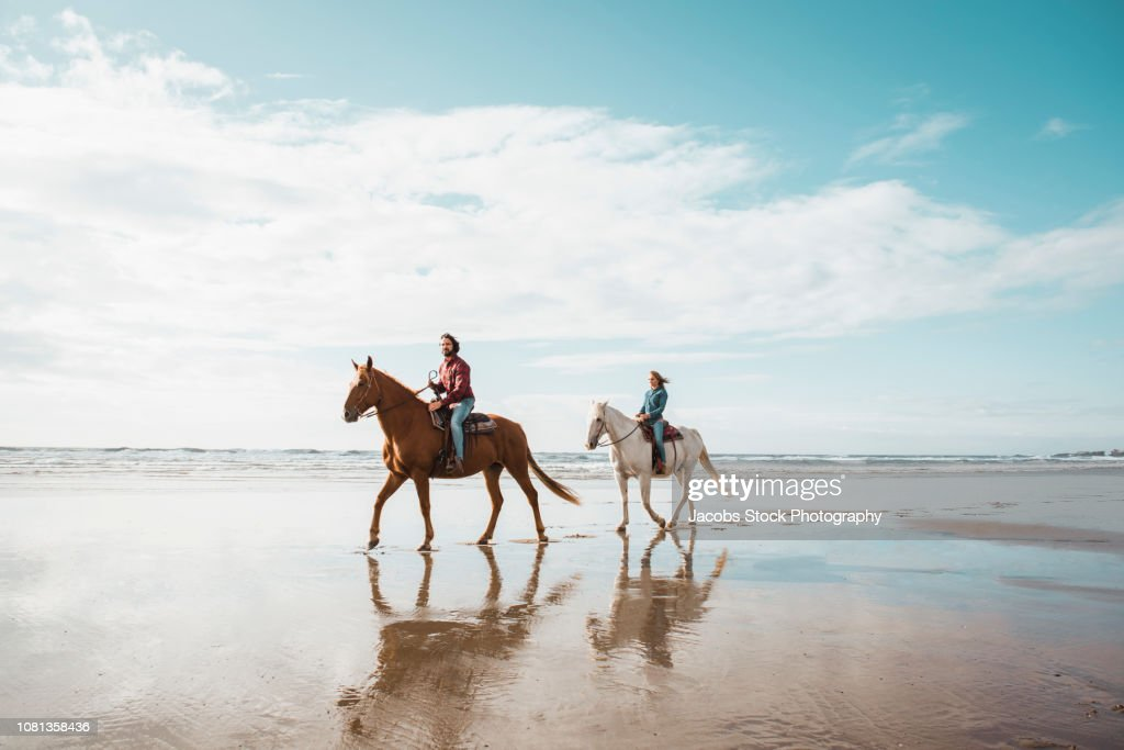 Couple Riding Horses High Res Stock Photo Getty Images