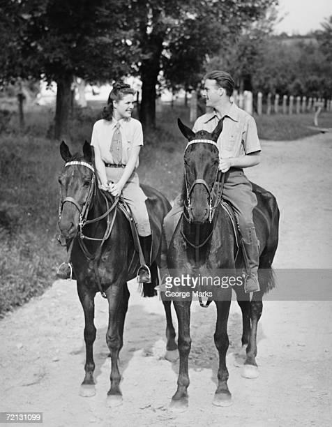 Couple riding horses (B&W)