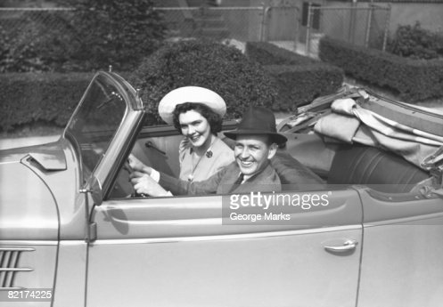 couple riding in old fashion convertible car portrait photo getty images. Black Bedroom Furniture Sets. Home Design Ideas