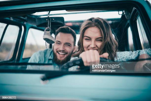couple riding in vintage car and having fun - cool cars stock pictures, royalty-free photos & images