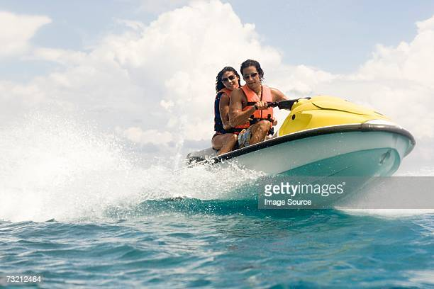 Couple riding jet ski