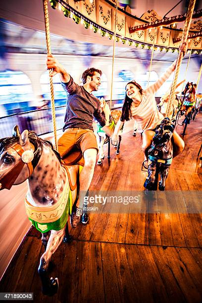 Couple riding merry-go-round in LA