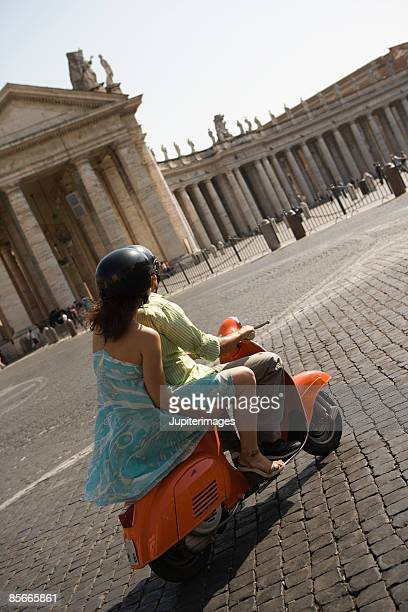 Couple riding motor scooter , Saint Peter's Square , Vatican City , Rome , Italy