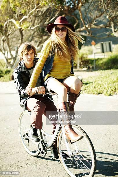 A couple riding on a bike.